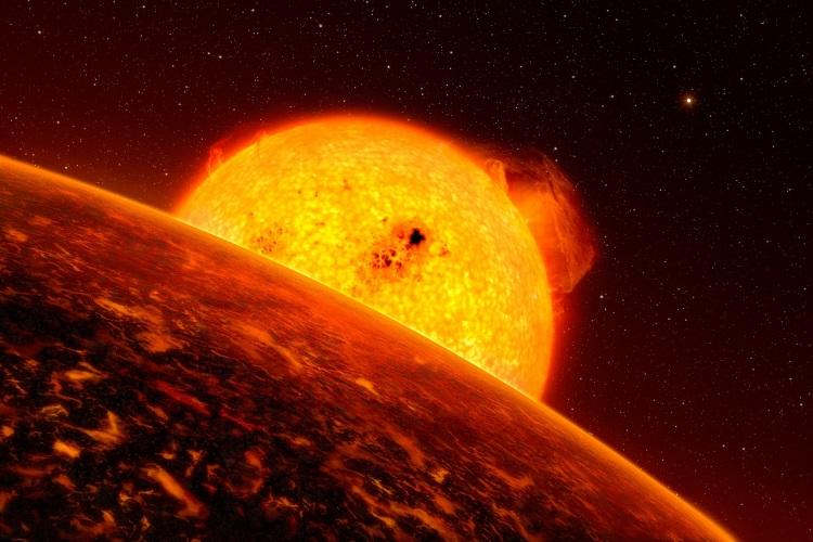 Artystyczna wizja aktywnej geologicznie powierzchni egzoplanety K2-141b i jej gwiazdy. Fotografia: nerdist.com.